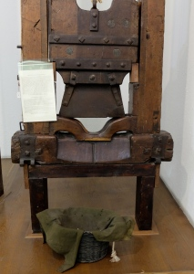 a guillotine with moth eaten basket
